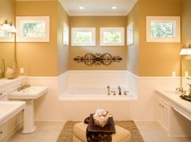 Custom master bathroom with jacuzzi tub and pedastal sinks.